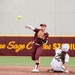 Gophers shortstop Carlie Brandt threw to first as Michigan's Julia Jimenez slid into second base during Game 2 of a doubleheader at Jane Sage Cowles