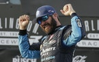 Martin Truex Jr. celebrated in Victory Lane after winning the NASCAR Cup Series race at Darlington Raceway on Sunday.