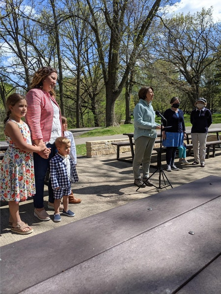 U.S. Sen Amy Klobuchar, at microphone, gathered with several moms on Mother's Day at Kordiak Park in Columbia Heights to urge people to get COVID-19