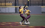 Gopher Delanie Cox left caught a fly ball in front of teammate MaKenna Partain (3) in the second inning.