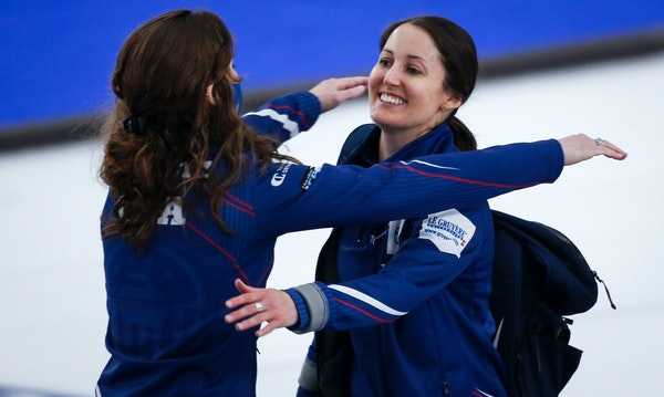 United States skip Tabitha Peterson of Minneapolis, right, celebrated with a teammate after defeating Sweden for the bronze medal at the women's wor