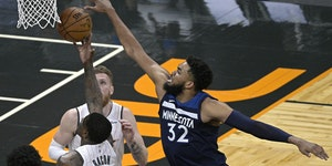 Wolves center Karl-Anthony Towns blocked a shot by Magic guard Dwayne Bacon (8) during the first half of Minnesota's 128-96 victory Sunday.