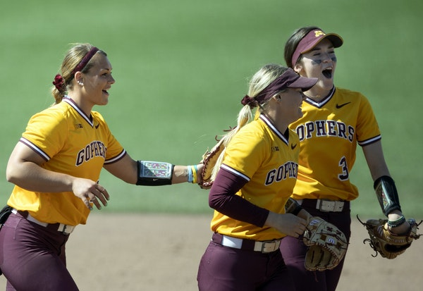 Gophers pitcher Amber Fisher left, joined fellow seniors and core players MaKenna Partain (3) and Carlie Brandt for a postgame celebration after recor