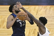 Wolves center Karl-Anthony Towns was fouled by Magic center Mo Bamba during the first half Sunday. Towns has dealt with injuries and personal losses d