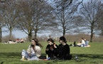 FILE - In this Monday, March 29, 2021 file photo, groups of people picnic in Hyde Park, London, as lockdown easing begins. British Prime Minister Bori
