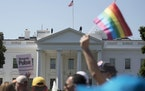 FILE - In this Sunday, June 11, 2017 file photo, Equality March for Unity and Pride participants march past the White House in Washington. The Biden a