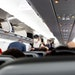 Travelers board a Jet Blue flight from Orlando to Washington. The Federal Aviation Administration said it had fielded 1,300 complaints of unruly passe