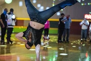 Steve Sweat of Mankato did a handstand Saturday during the final day of skating at Roller Garden in St. Louis Park.