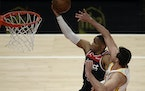 Wizards guard Russell Westbrook put up a layup against the Hawks' Danilo Gallinari in the second half Monday. Westbrook broke Oscar Robertson's ca