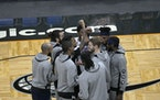 The Wolves gathered after pregame introductions on Sunday before beating Orlando.