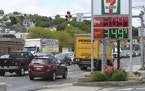 Traffic moves along Pennsylvania Route 61 as gas prices are seen on the sign at a Sunoco gas station at East Norwegian Street in Pottsville, Pa., on M