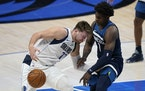 Mavericks guard Luka Doncic loses control of the ball as he works against Wolves rookie Anthony Edwards, the No. 1 ovverall draft choice in 2020.