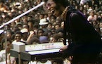 """Searchlight Pictures Sly Stone performing at the Harlem Cultural Festival in 1969, featured in the documentary """"Summer of Soul."""""""