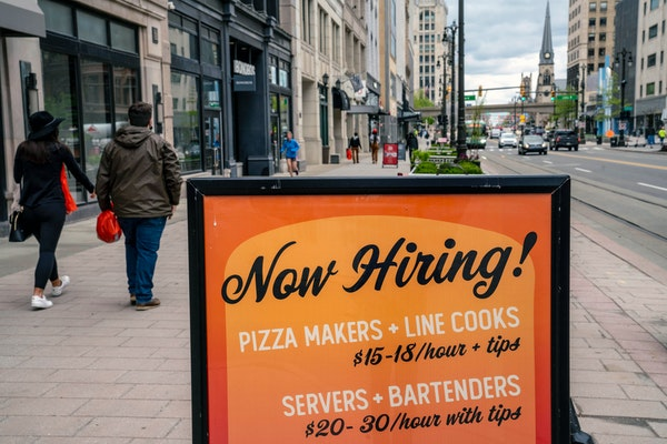 A sign advertising job openings at a restaurant in Detroit on Wednesday, May 5, 2021.