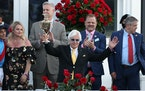 Trainer Bob Baffert raised the trophy after winning the 147th running of the Kentucky Derby with Medina Spirit, his seventh career Kentucky Derby win,