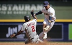 Luis Arraez slides into second base against Milwaukee last month.