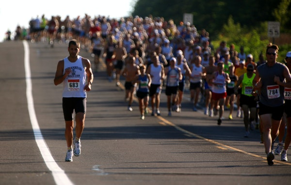 FILE - John Stien broke away from the pack in the 2009 Grandma's Marathon. The marathon announced Tuesday it would allow race spectators and live mu
