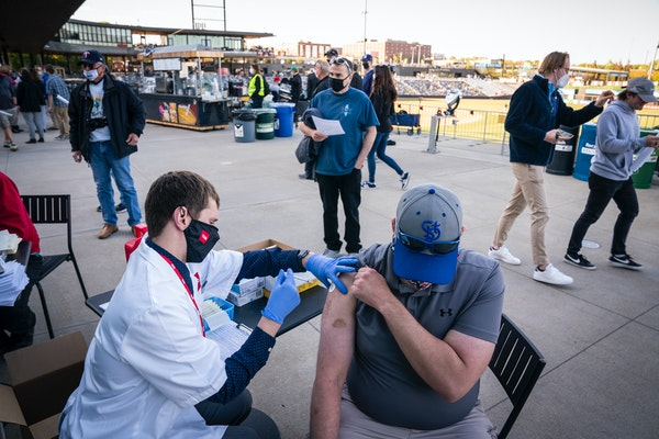Matt Anderson of West St Paul got the Johnson & Johnson COVID-19 vaccine at the St. Paul Saints home opener in St. Paul on Tuesday.