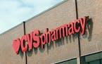 A sign for a CVS Pharmacy.