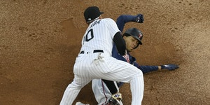 White Sox third baseman Yoan Moncada tags out Andrelton Simmons at third during the second inning