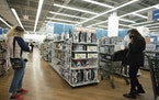 FILE - In this March 25, 2021 file photo, shoppers look at items in Bed, Bath and Beyond, in New York. U.S. consumer prices surged 0.8% in April, push