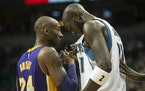 Los Angeles Lakers forward Kobe Bryant (24) and Minnesota Timberwolves forward Kevin Garnett (21) stood side by side during a break in first quarter a