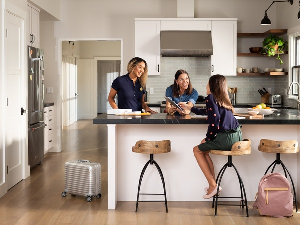 Enjoy Technology sends knowledgeable sales representatives, depicted in this company-provided image by the woman on the left, to meet with consumers i