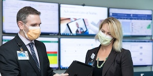 Mayo Clinic physicians Dr. Michael Maniaci, and Dr. Margaret Paulson, the physician leads for Mayo's Advanced Care at Home, at the Command Center in
