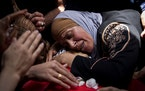 A Palestinian woman mourns over her son Rasheed Abu Arra, who was killed in clashes with Israeli forces, during his funeral in the Village of Aqqaba n