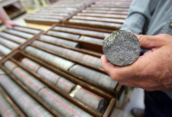 In 2011, David Oliver, manager of special projects, held a sample that had metal speckles from the boxes of core samples at Twin Metals in Ely, Minn.