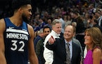 Wolves center Karl-Anthony Towns joked with team owner Glen Taylor and his wife after a 2019 game.