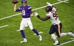 Minnesota Vikings quarterback Kirk Cousins (8) threw under pressure from Chicago Bears nose tackle Bilal Nichols (98) in the third quarter. ] ANTHONY