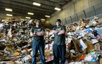 Nate Riddle and Tim Kachel stand at the recycling plant where they found Parker Hanson's prosthetic arm on Tuesday.