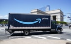 An Amazon truck drives in in Philadelphia, Friday, April 30, 2021.