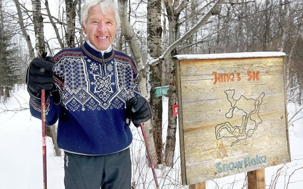 Provided by Jane Hovland George Hovland stands next to a trail he named for his wife, Jane Hovland, at Snowflake Nordic Ski Center in Duluth in an und