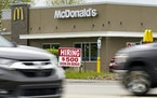 A hiring sign offers a bonus outside a McDonald's restaurant in Butler County, Pa., on Wednesday, May 5, 2021.