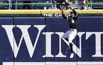 Chicago center fielder Billy Hamilton went to the wall to catch a ball hit by the Twins' Kyle Garlick with the bases loaded in the fourth inning Thu