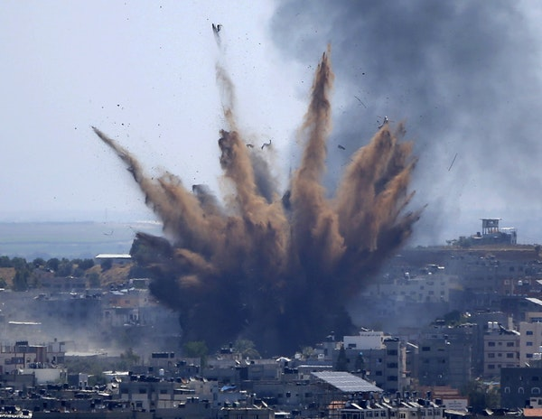 Smoke rises after Israeli airstrikes on in Gaza City on May 13.