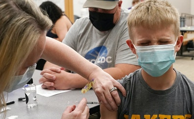 Lincoln Schlagel, 13, of Howard Lake, Minn., winced as he got his first dose of the Pfizer COVID-19 vaccine Thursday at Children's Minnesota.