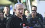 Israeli Prime Minister Benjamin Netanyahu met with Israeli border police on Thursday, May 13, 2021, in Lod, near Tel Aviv, after a wave of violence in