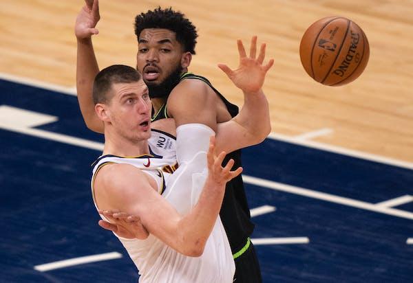 Denver center Nikola Jokic and Timberwolves center Karl-Anthony Towns were both called for fourth quarter fouls.