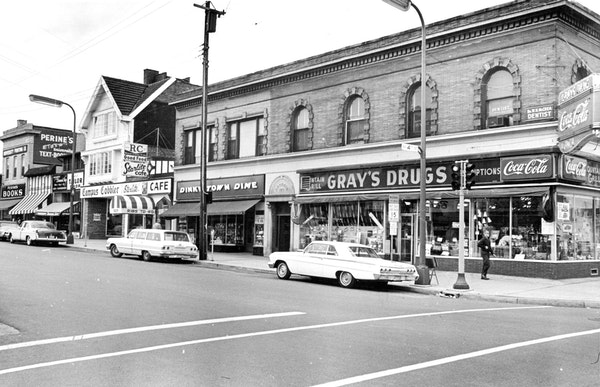 The Grodnik Building, which now houses Loring Pasta Bar, on the corner of 4th Street and 14th Avenue SE in 1963. To its left is Dinky Town Dime variet
