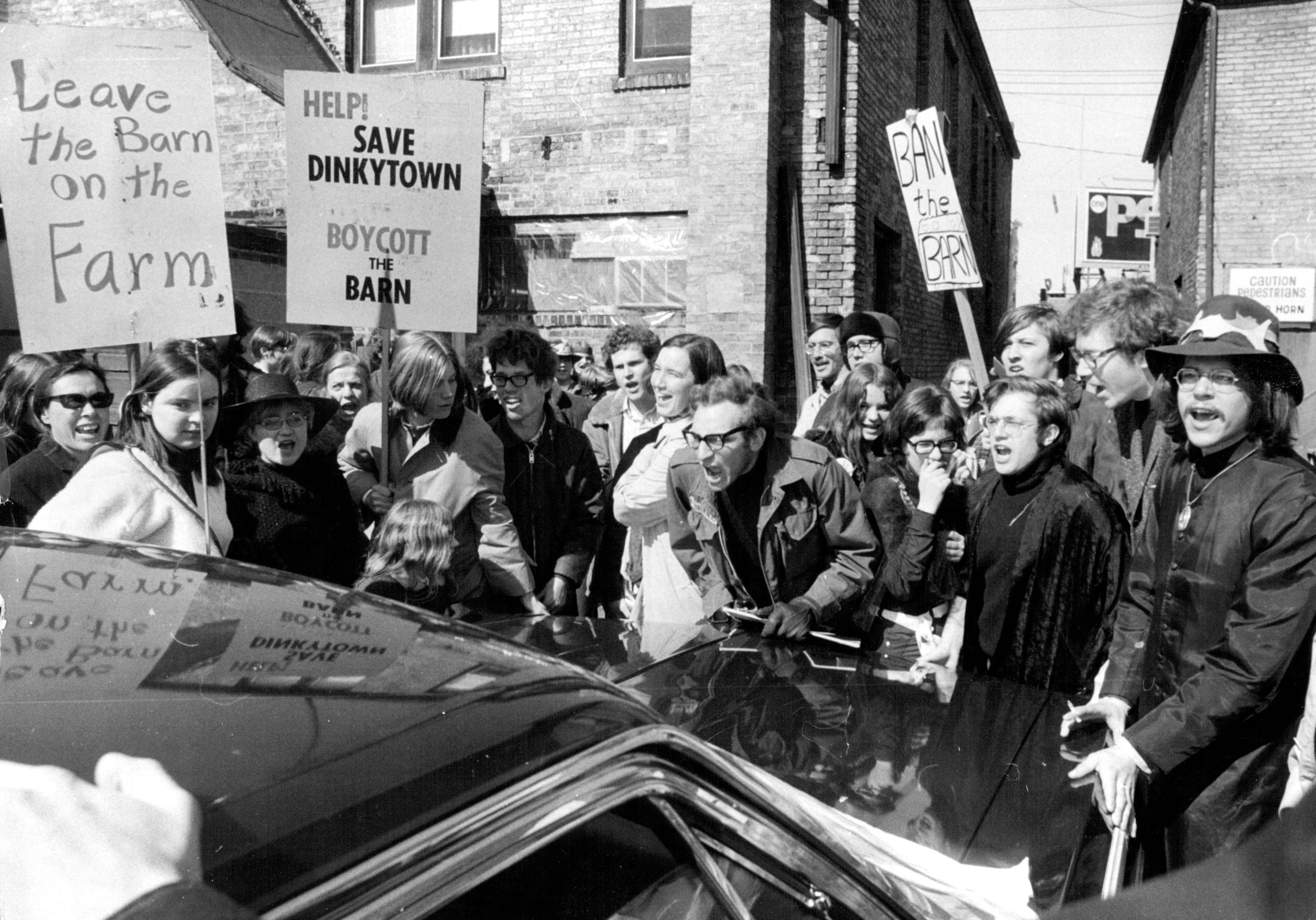Protestors confront a Red Barn official and the property owner of the proposed Red Barn site in March 1970.