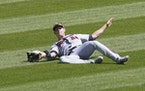 Minnesota Twins' Max Kepler is unable to catch a broken bat fly ball from Chicago White Sox's Yoan Moncada during the third inning of a baseball g