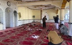 Afghan journalist take photos and film inside a mosque after a bomb explosion in Shakar Dara district of Kabul, Afghanistan, Friday, May 14, 2021.