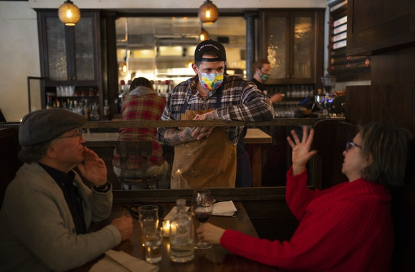 Top, chef Joshua Hedquist visited with John and Lisa Keiser at a Joey Meatballs pop-up at Tilia last month. Above, a tattoo on Hedquist's arm depict