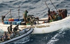 This photo provided by the French Army shows French soldiers arresting suspected pirates off Somalia in 2009.