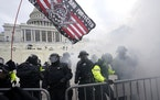 FILE - In this Jan. 6, 2021, file photo, police try to hold off supporters of then-President Donald Trump who tried to break through a police barrier,