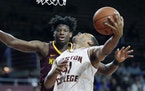 Boston College's Steffon Mitchell (41) shoots against Minnesota's Daniel Oturu during the first half of an NCAA college basketball game in Boston,