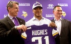Minnesota Vikings first round pick cornerback Mike Hughes from the University of Central Florida, with Vikings general manager Rick Spielman, left, an